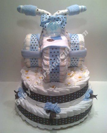 How to Make A Diaper Cake - Unique baby shower gift ideas.  You probably have everything you need to make this now and at home!  Learn how to make...
