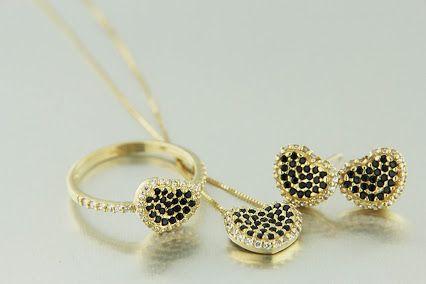 Dalla Collezione Shine Adriano Facco, parure in 18kt oro giallo con pietre preziose