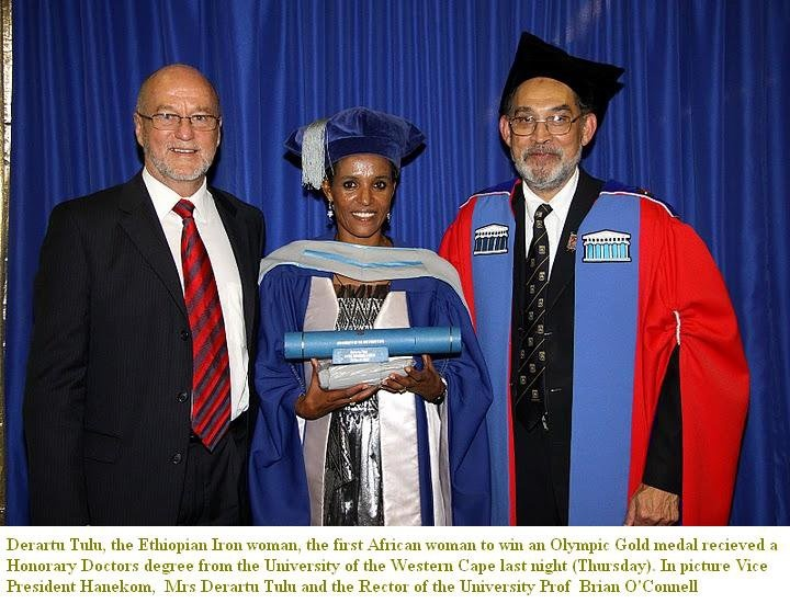 Daraartu Tulluu (Derartu Tulu), Oromo athlete and Olympian, the first African/ Oromian woman to win Olympic  Gold medal (Barcelona, 1992) received Honorary Doctors  from the university of the Western cape. In picture: Vice President Hanecom, Daraartuu Tulluu and the Rector of the University of Western Cape, Prof. Brian O'C'onnell.