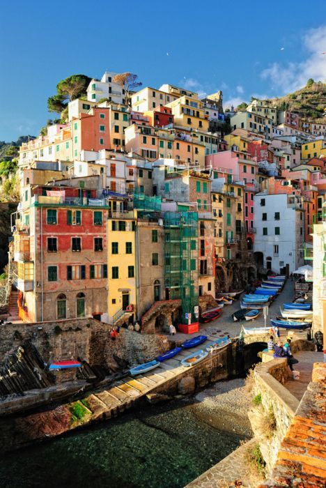 Cinque Terre! The Italian Riviera. Riomaggiore is a tiny, colorful village cut into the rocks.