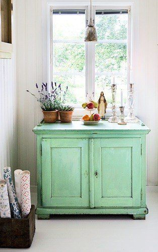 swedish style summer house with the most stunning mint green coloured vintage cabinet and a big box of vintage wallpaper