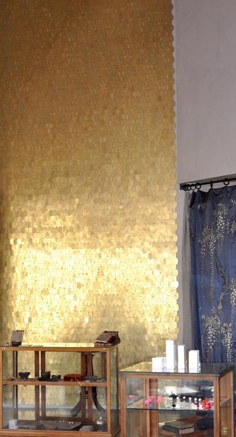 impact: tumbled brass discs nailed to the wall via: lorrainepennington