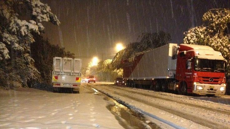Snow dumps down on Blackheath in the Blue Mountains making roads slick.