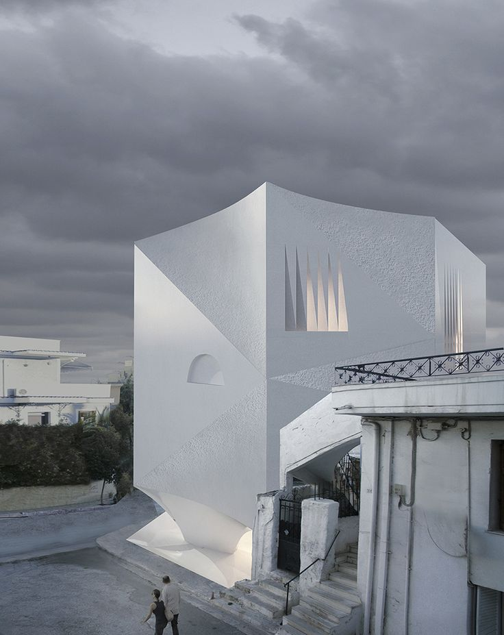 H50 apartment block by 314 architecture studio exposes raw marble through triangular curved faces