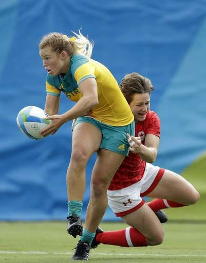 Australian women win 1st gold medal for Olympic rugby sevens  -  August 8, 2016  -     Australia's Emma Tonegato, left, is tackled by Canada's Ghislaine Landry, during the women's rugby sevens semi final match at the Summer Olympics in Rio de Janeiro, Brazil, Monday, Aug. 8, 2016. (AP Photo/Themba Hadebe)  -  August 8, 2016