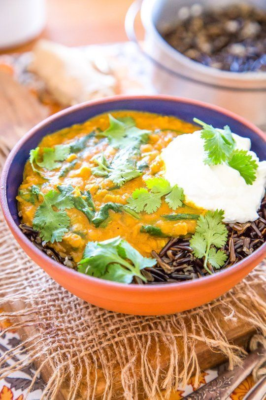 wild rice bowl with red lentil curry and spinach