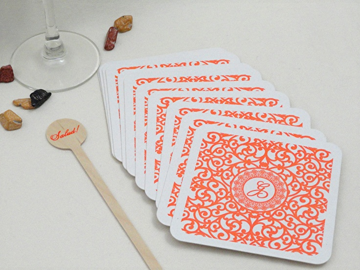 scroll designed beverage coasters for Spanish themed wedding with salud! drink stirrers. by www.impressmedesigns.com