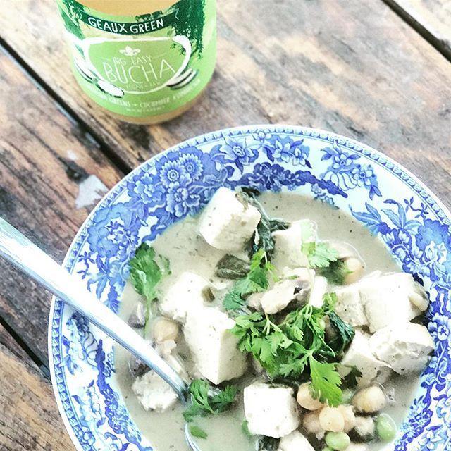 How we #geauxgreen: #bigeasybucha #kombucha with #southern #greens (#kale, #collards, and #local #cucumbers) + #homemade #thai #style  #lemongrass #coconut #edamame and #tofu #soup #vegan #vegandinner #vegansofig #vegan in #neworleans