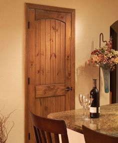 Knotty Pine Panel Arch Doors we're putting throughout the house, except ours are stained in Red Mahogany. So beautiful