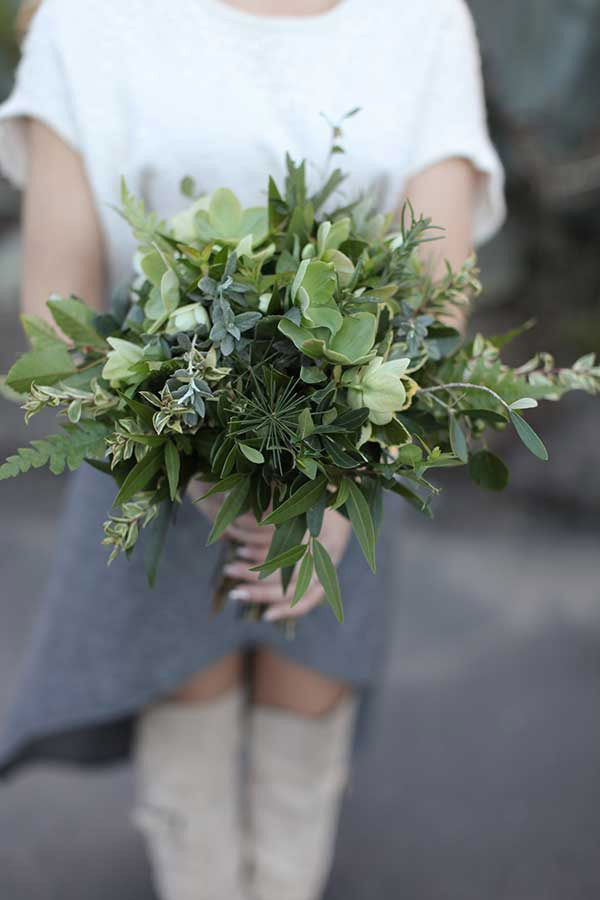 A bouquet of greenery and herbs is the ideal complement for a no-fuss, early spring bride. #Weddings