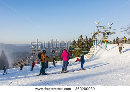Wierchomla Mala, Poland - January 02, 2016: Family spending the weekend skiing on piste.