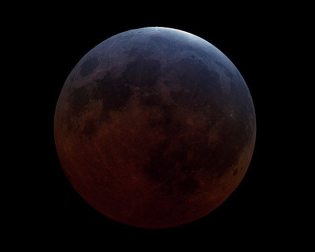 Lunar eclipse of April 2015. Totality was supposed to be very short, but observers report that it didn't even quite happen. There was still a sliver of sunlight on the Moon even at its darkest. (Image credit and copyright: Rolf Wahl Olsen)