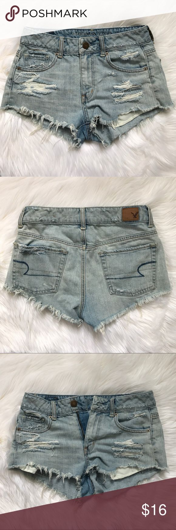 American Eagle Distressed Jean Shorts Distressed American Eagle Jean Shorts. Zip  up & button closure. Three front functioning pockets l. Two back functioning pockets. Waist 14.5 Length about 12 inches. Great Condition. American Eagle Outfitters Shorts Jean Shorts