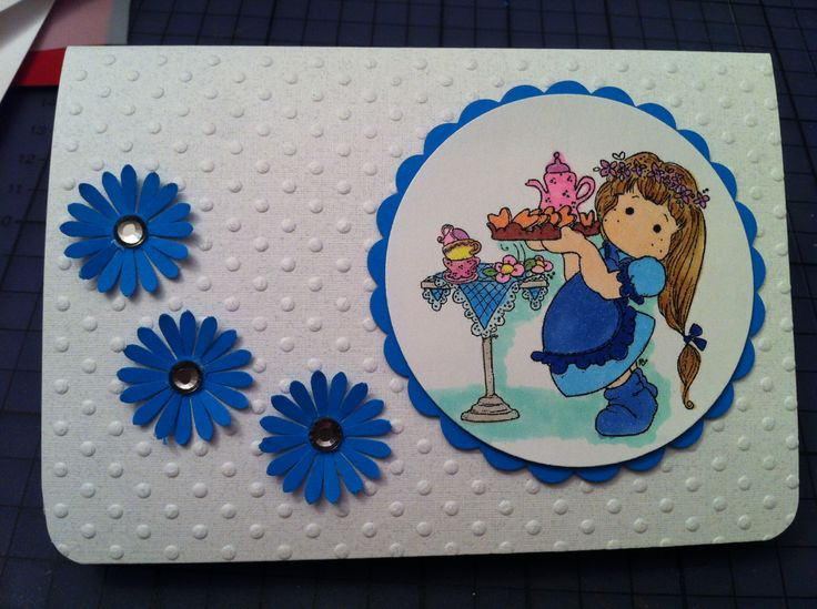 """""""Young Lady"""" - A collection that covers 12 months of stationary needs.  Birthday or Anniversary Embossed paper; diecut and stamped; Copic markers used to color the stamp; Daisy diecut ornaments, silver faceted rhinestones"""