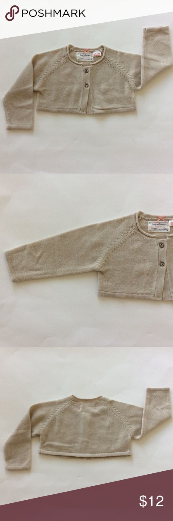 👫Zara Knitwear Baby Girl's cropped cardigan Zara Knitwear Baby Girl's cropped cardigan sweater. Oatmeal color. 2 buttons. Long sleeves. Super soft. Size 9-12 mths. Excellent condition. Zara Shirts & Tops Sweaters