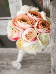 i love ranunculus. they look like they are made of paper, with a button in the middle.