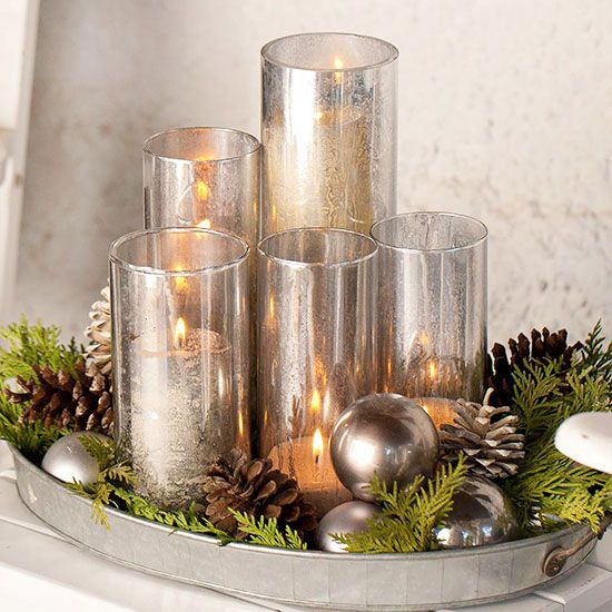 Candle Collection One of the best places to find outdoor decorating accents? Your kitchen. Take this silver serving tray: It offers the perfect receptacle for a collection of shimmery candleholders, evergreen sprigs, pinecones, and holiday ornaments. To create your own similar setup, tuck in the big items first -- here, orbs and pinecones -- and then fill in empty spaces with greenery.: