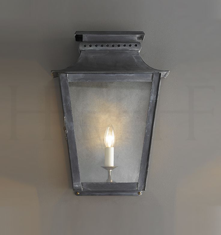 "Zeus Wall Lantern, Large.   18.7""H x 12.7""W. x 8.26""Depth at top.  Fixture tapers.  Zinc (shown) or Antique brass"