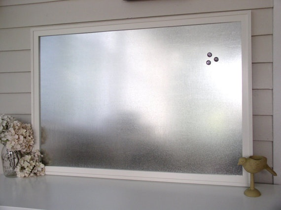 I think I need to make one of these! Framed sheet metal for a magnetic memo board.