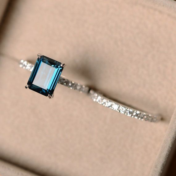 Emerald Cut Topaz Engagement Ring: A distinct emerald cut can be a stunning ring choice. This is one of our favorite topaz engagement rings for its unmatched vintage look. Also, this cut makes the stone appear larger and your finger more slender. | Citrine and Topaz Engagement Rings