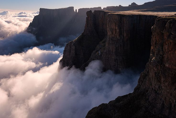 Drakensberg World Heritage Site, South Africa Looking East in the mornings provides a dramatic view of the amphitheater wall, which features some of the highest cliffs in the world.
