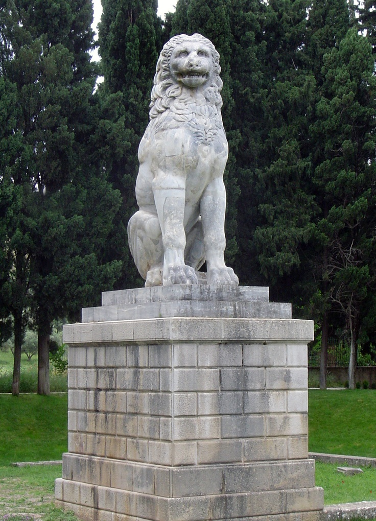 """Lion monument to the Sacred Band of Thebes, most of whom probably died in the Battle of Chaeronea in 338 BC. This military force, the elite of the Theban army, consisted of 150 sets of male lovers. At Chaeronea, they held their ground, and nearly all fell where they stood, as it was observed at the time, """"heaped one upon another."""" The lion, erected 40 years later, was always thought to stand at the battle's site, and when excavated in 1890, revealed 254 skeletons, arranged in rows."""