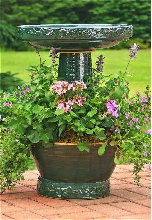 I love this birdbath with its own private garden---great place to plant colorful annuals: Gardens Ideas, Gardens Complete, Flowers Pots, Planters Combos, Flowers Beds, Locks Tops, Planters Rings, Birds Bath,  Flowerpot
