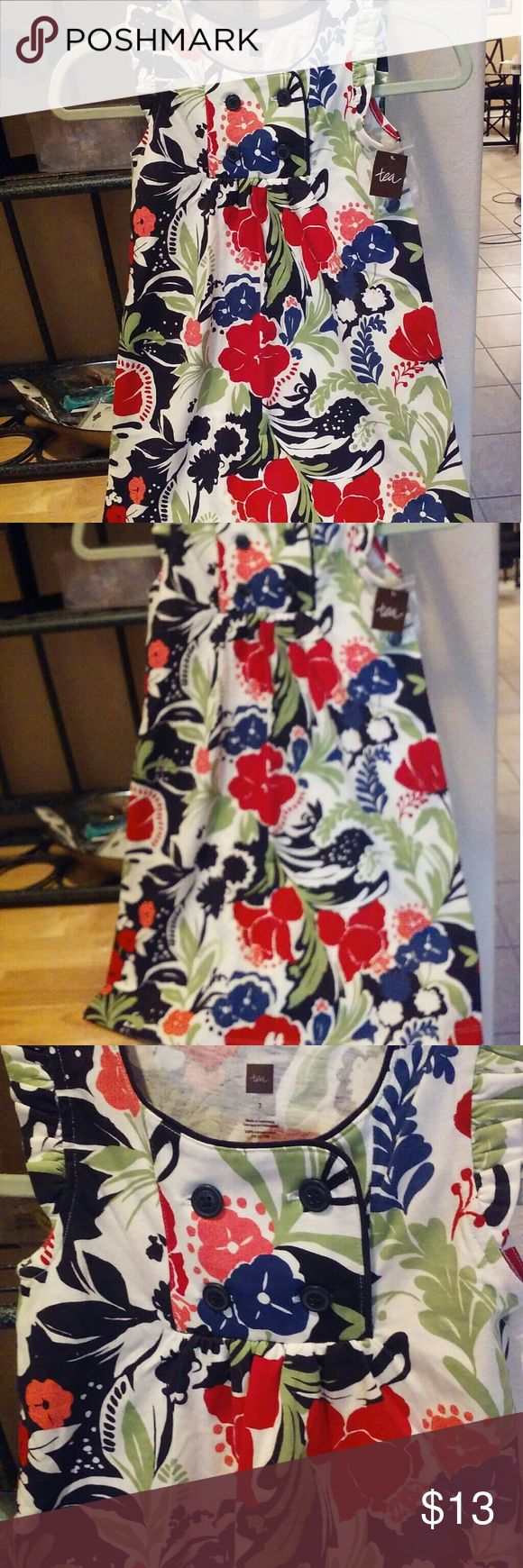 """Tea Collection Cotton Knit Cap Sleeve Dress Bold floral girl's cotton knit dress with cap sleeves and a kind of nautical design bodice with button detail. Lgth. is 26"""", arm to arm is 12 1/8"""". NWT- store tag, no price tag- online purchase Tea Collection Dresses Casual"""