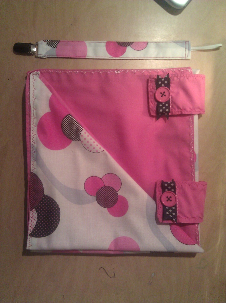 Price $29.00  Trendy Car seat cover and matching  Stylish  pacifier clip  . The cover is attached with 2 Velcro straps and keeps the car seat handle out  for easy access to hold carrier. The cover is finished off with cute buttons
