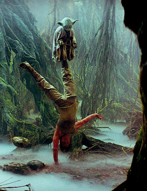 One arm hand stand and telekinesis by Luke Skywalker carrying Yoda