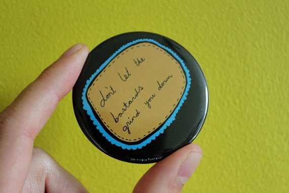 Pocket Mirror: Quote - Randy Newman 'Don't let the Bastards Grind you Down' by Nicola Clare.
