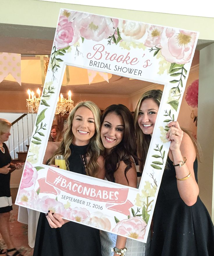 Bridal shower photo booth idea - photo frame for bridal shower with floral motif + hashtag {Courtesy of Etsy}