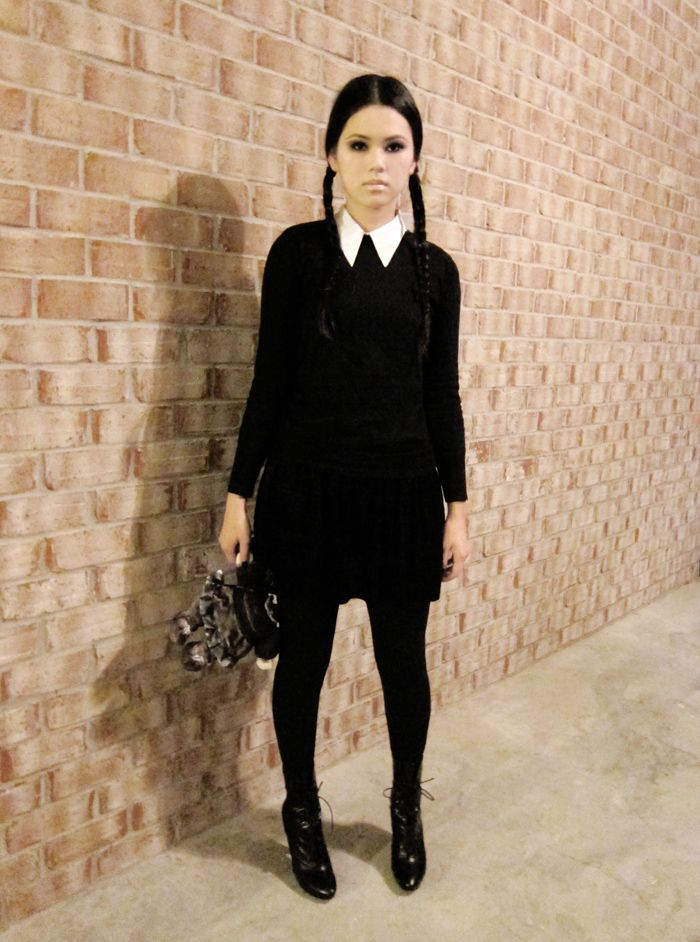 Wednesday Addams. I'm gonna rock this costume this year! I already have a black skirt, sweater, tights, shoes, and pleat hair. all i need is the white shirt.