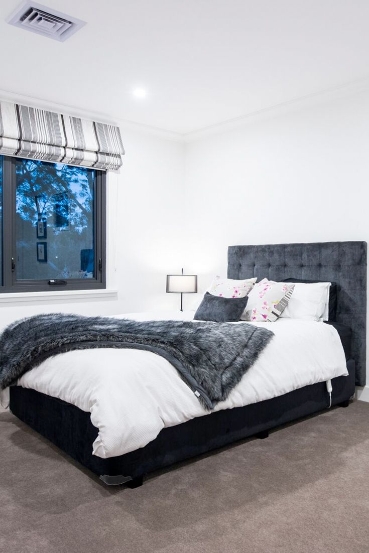 Teenager bedroom design in charcoal, silver and a touch of pink. Upholstered charcoal bedhead adds a touch of luxury.