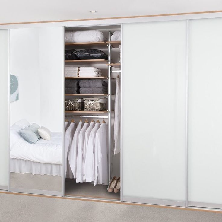 Full length mirrors on wardrobe doors, slide back to reveal a clutter free, organised bedroom closet. We design & install fitted furniture in all rooms of a home, all over London.