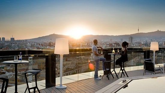"""A must-do while visiting the Barcelo Raval Hotel is to take the lift to the rooftop terrace to enjoy elliptical 360-degree panoramic views of Barcelona. The best time to arrive is at sunset. Order a cocktail, enjoy the endless views over Barcelona and watch the sun disappearing at the horizon from this futurist """"spaceship"""" that contrasts its surroundings. #rooftop #BestView #Barcelona #360 #panoramic #BarceloRaval #Hotel"""