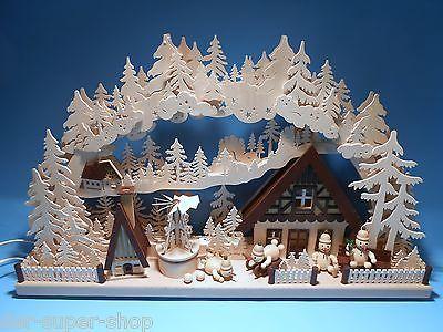 Schwibbogen 3D mit 4 Figuren Schneemannland mit Pyramide 72 x 44 cm Erzgebirge