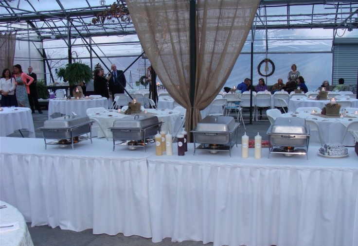 Buffet table at Callie and Michaels greenhouse wedding at Scheiderer Farms.