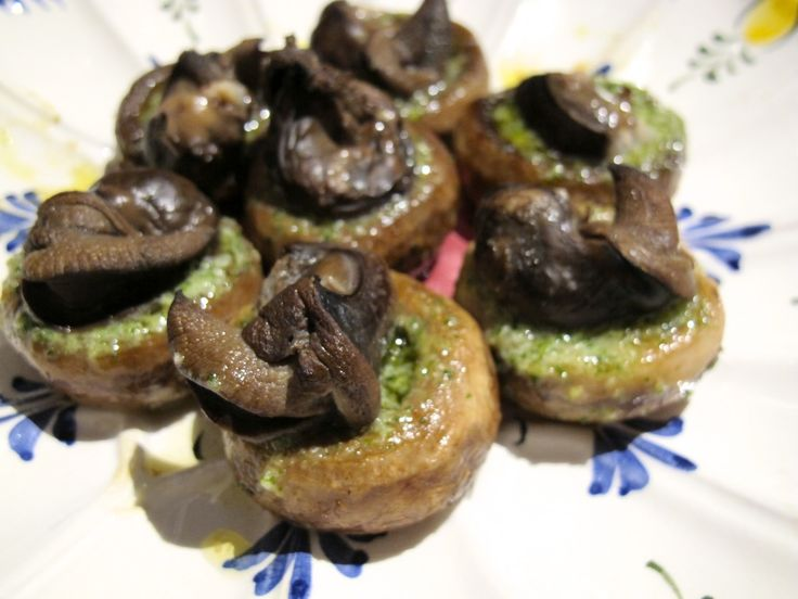 The quintessential French dish of escargot gets an even more decadent spin when you add an herbed butter and place it in a grilled mushroom cap.