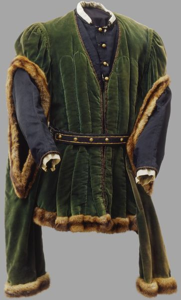 [Theatre costume] Green velvet doublet trimmed with fur, with black grosgrain insert at the yoke and brass buttons at the front.  Belt. Place of origin: London, England  Date: 1944  Artist/Maker: Zinkeisen, Doris Clare, born 1898 - died 1991 (designers)  B. J. Simmons & Co. (Theatrical costumiers)