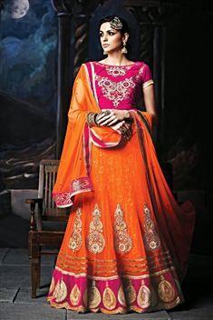 Orange Net and Velvet Wedding Wear Lehenga Choli