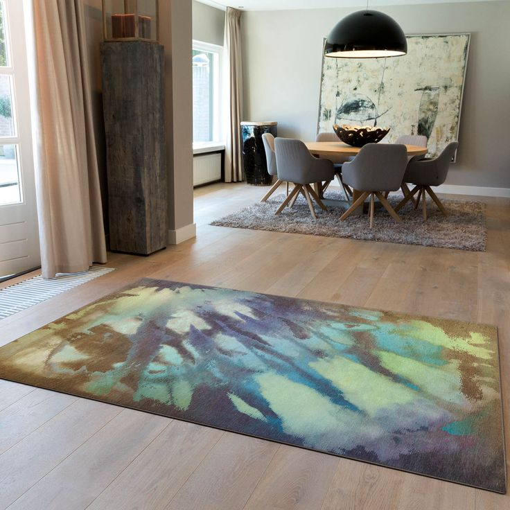 An abstract rug which offers an eye catching design with a water colour effect with a selection of green, blue and brown colour tones. #LivingRooms #HomeDecor