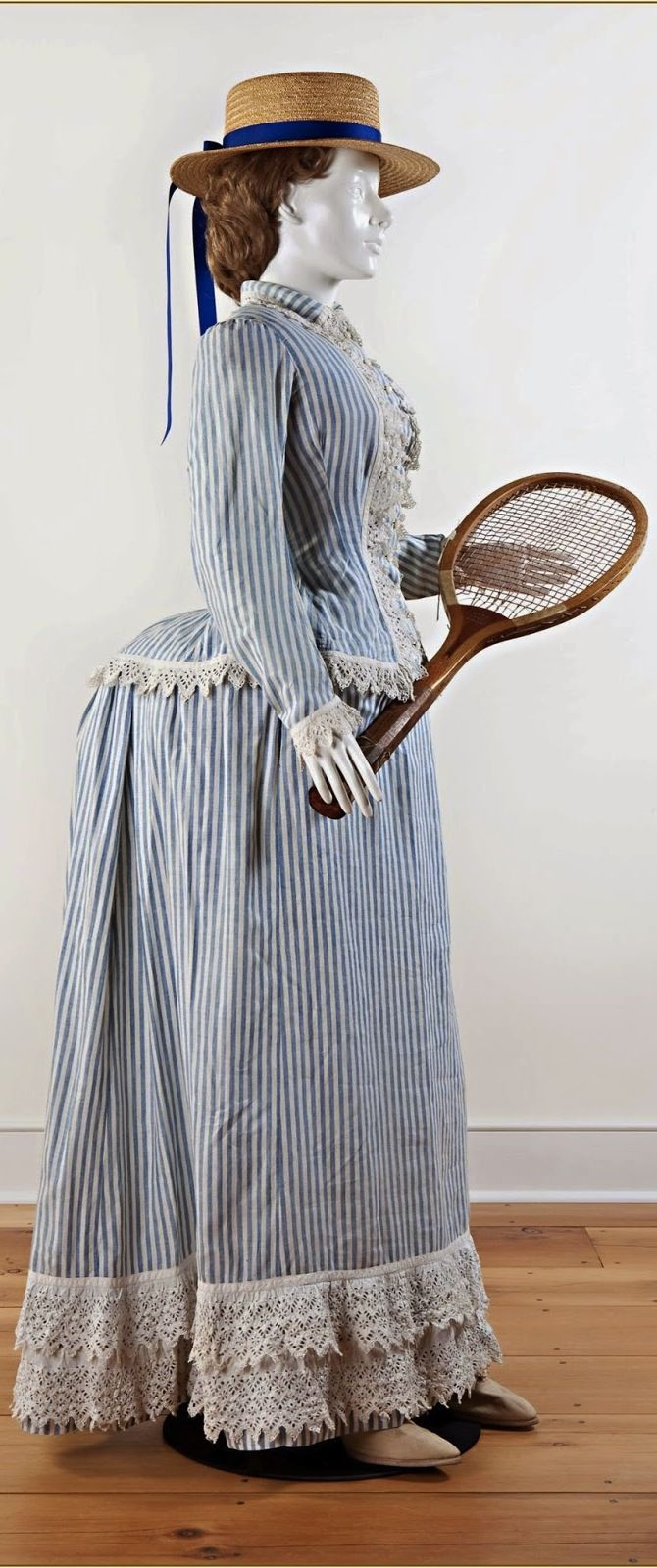 Tennis dress, c. 1885. Two piece blue and white striped cotton, Broderie Anglaise trim on jacket and hemline. Darien Historical Society.