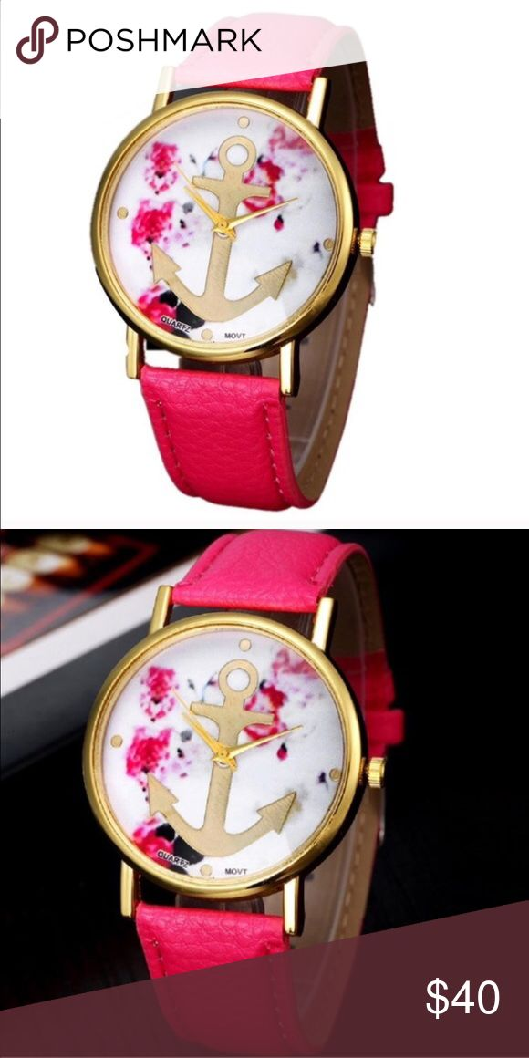 Pink and Gold Floral Anchor Watch Quartz movement Watch. Face has floral print with gold anchor detail. Pink leather watch band. Face is alloy. Accessories Watches
