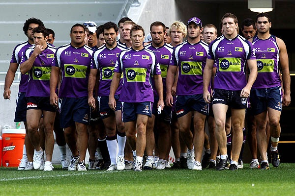 Surrounded by his players, Melbourne Storm coach Craig Bellamy - What a day... Eff you David Gallop!