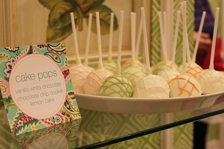 Cake Pops. Are these the Tupperware Party of Food or what? Who had this idea for gathering up cake that didn't make it, smooshing it and poking a Popsicle brand Frozen Dessert stick in it? Worse, who then was struck with the Brilliant Idea of making molds so the cake can be baked in this shape? From where did their startup financing come? There's one born every minute and they all want to bake.
