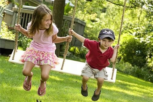 """Why not install a tree swing in your landscape? You know, """"for the kids""""! Nobody has to know who will be swinging on it while they're away at school. From Breezy Wooden Swings. More tree swing ideas here: http://www.landscapingnetwork.com/products/play/tree-swings.html"""