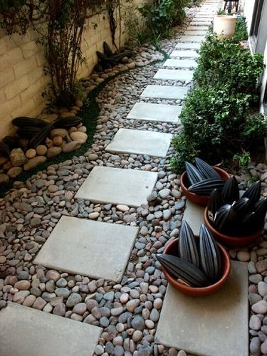 walkway from driveway to front door - but need edging so stones don't go flying when grass is cut