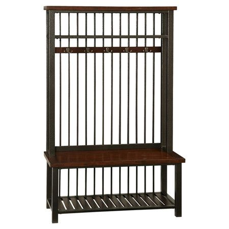 Poplar wood hall tree with five double-hooked coat rings and a slatted bottom shelf.  Product: Hall treeConstruction...