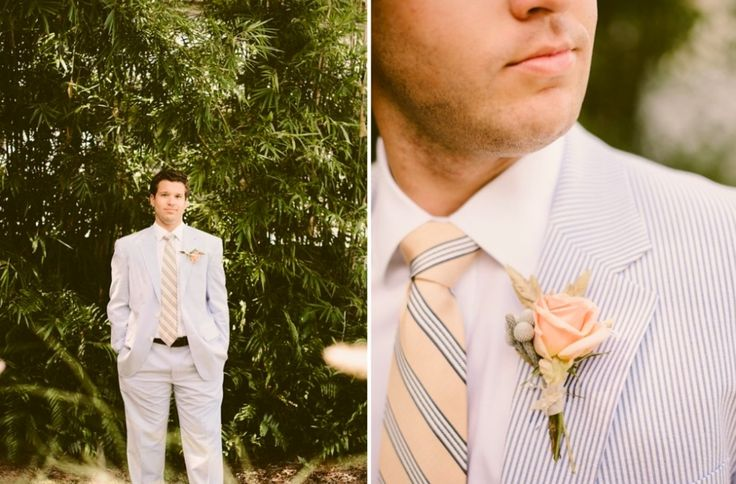 Boutonnière for a seaside wedding of peach spray rose, sea grass and silver brunia.